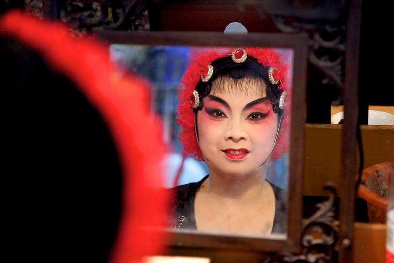 Chinese opera singer in dressing room, Chengdu China