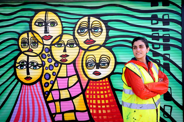 FEATURES / Mark Rees<br /> wednesday 13th April 2016<br /> Swansea High Steet art Scene...<br /> Cypriot artist Photini Matsi (07597514359) outside her mural on the Community Stores building, High Street.