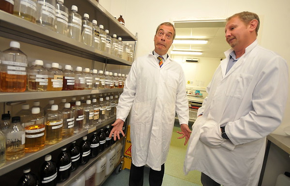 SWANSEA / David<br /> Friday 23rd October 2015<br /> UKIP's Nigel Farage visiting Swansea vaping company 'Celtic Vapours' speaking with director Jim Salter in the firms laboratory.