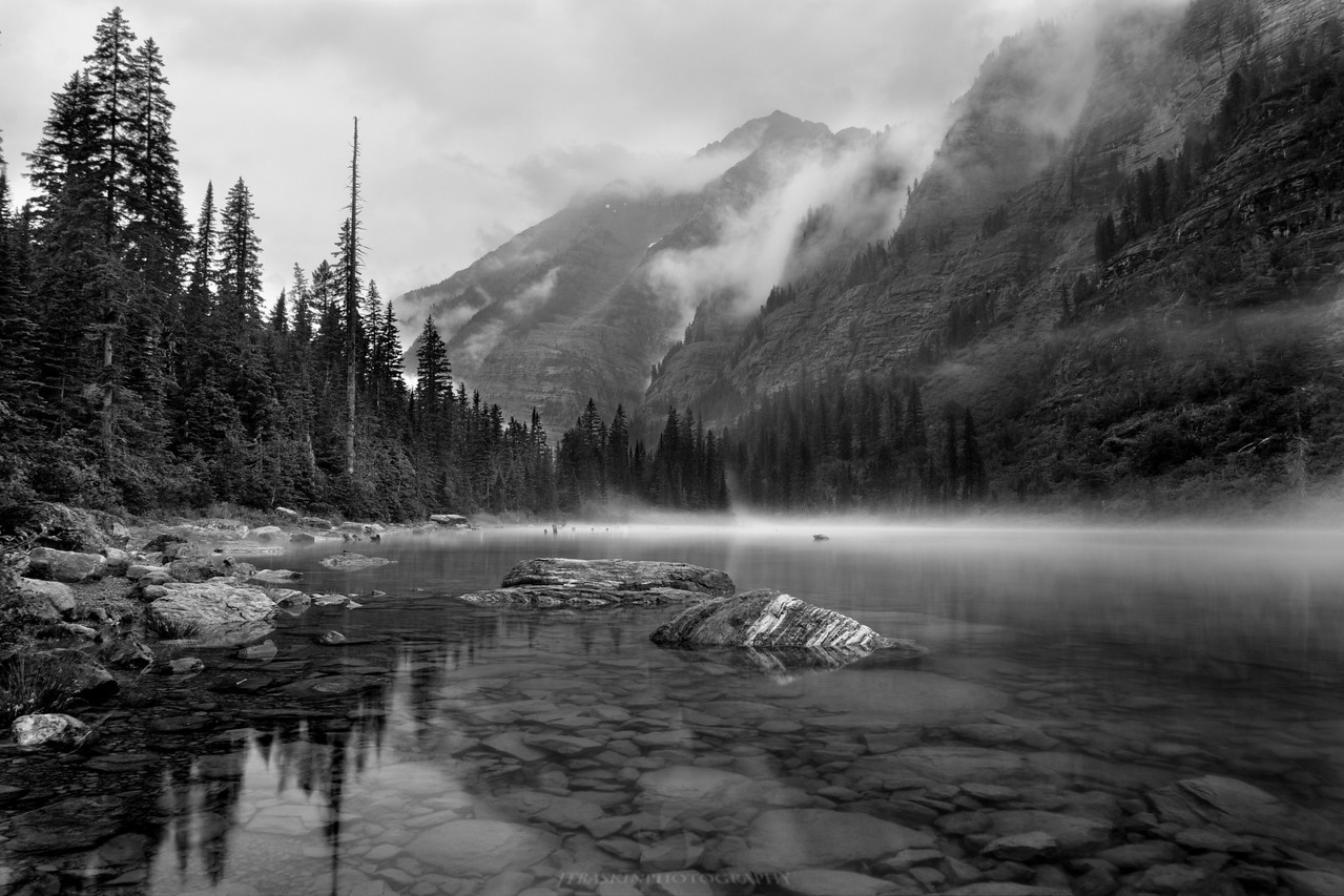 Avalanche Lake - GLacier National Park, MT<br /> IMG_9150<br /> <br /> During a rainy gloomy day we made the hike up to Avalanche Lake. The trail winds through a lush green forest and ends at this picturesque lake.  The flat lighting and drab atmosphere worked particularly well in black and white.<br /> <br /> This image will be sold as a limited edition numbered to 400.