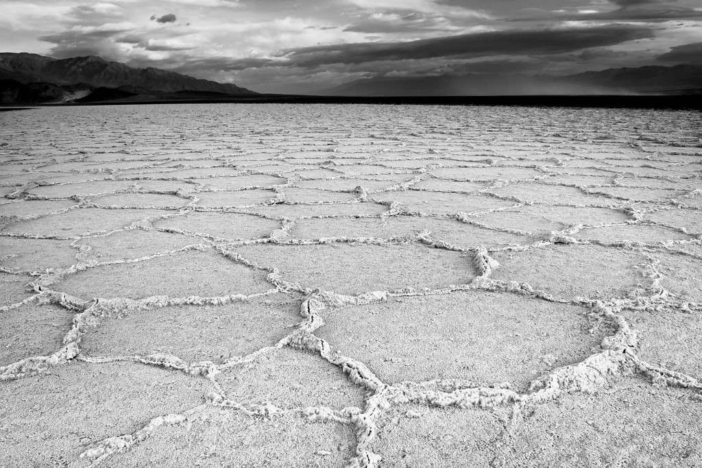 Trials and Tribulations - Death Valley National Park<br /> IMG_7655<br /> <br /> At 282 ft. below sea level this dry alkaline lake bed is home to the lowest point in North America. Badwater Basin's huge salt flats stretch over 200 square miles, making it one of the world's largest protected flats. Here salt crystals expand in the extreme climate and push the crust of the desert into rough, chaotic forms. Often times resulting in these famous polygonal patterns.