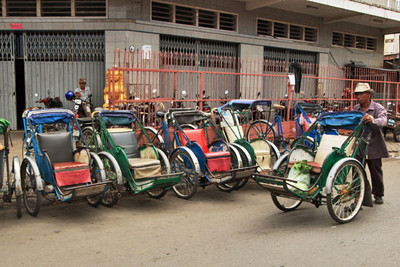 Row of human powered rickshaws in Phnom Penh