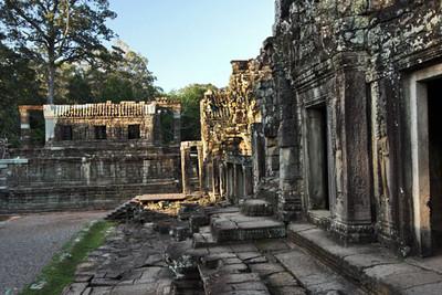 Afternoon sun illuminates Bayon ruins at Angkor Thom
