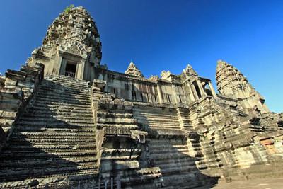 Dawn lights up spires at Angkor Wat