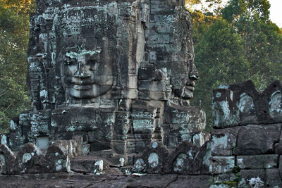 Giant Buddha heads on towers of Bayon ruins at Angkor Thom