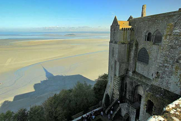 View over sand flats at low tide from the walled city of Mont Saint Michel