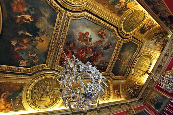 One of many elaborate ceilings in Versailles Palace