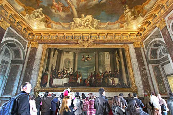 Crowds in Versailles Palace view enormous painting