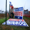 JAN SEEGER/Staff photo. <br /> Richard Burnes of North Andover, takes a break in making phone surveys at the Social Victory Center on West Broadway in Derry to take down Republican campaign signs that pose the danger of becoming airborne in the rising storm winds. Burns, who has been making an average of 400 political calls a day for the last three months, says that each one of the large signs costs appx. $100.