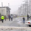 PAUL BILODEAU/Staff photo. <br /> Police move storm watchers from Ocean Front South as Hurricane Sandy moves in at Salisbury Beach.