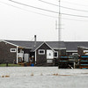 PAUL BILODEAU/Staff photo. <br /> The Hampton Boat Club is surrounded by water as the Hurricane Sandy storm surge moves in Hampton.