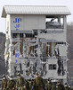 Ground Self-Defense Force members move past a damaged building for an operation to remove the debris from an area devastated by the March 11 earthquake and tsunami in Miyako, Iwate Prefecture, Japan, Thursday, April 7, 2011. (AP Photo/The Yomiuri Shimbun, Ken Satomi)