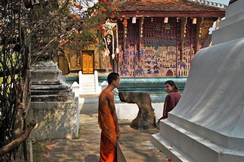 Monk chats at Wat Xieng Thong