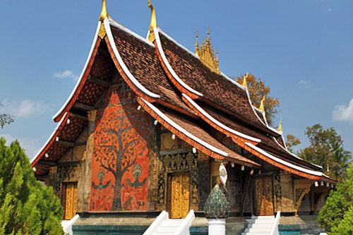 Tree of life mosaic on temple at Wat Xieng Thong