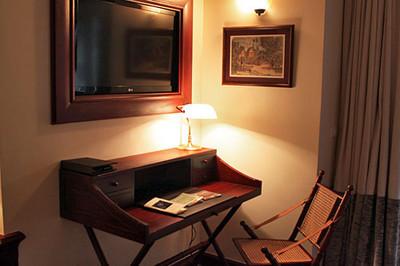 Writing desk & flat screen TV in Pioneer Suite