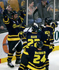 Merrimack's Mike Collins, left, celebrates his goal with teammates Stephane Da Costa (24) and Brendan Ellis (22) in the third period of a Hockey East tournament semifinal hockey game against New Hampshire, Friday, March 18, 2011, in Boston. Merrimack won 4-1. (AP Photo)