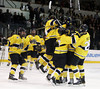 DAVID LE/Staff Photo. Eagle-Tribune. The Merrimack College hockey team mobs freshman defenseman Jordan Heyward after he scored the winning goal in OT to give the Warriors a 3-2 victory over UNH on Saturday night. 2/12/11.