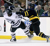Merrimack's Fraser Allan, right, checks New Hampshire's Matt Campanale (24)in the first period of a Hockey East tournament semifinal hockey game, Friday, March 18, 2011, in Boston. (AP Photo)