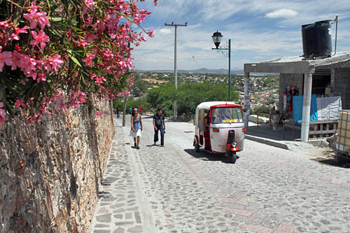 Mini taxis carry tourists up to the base of La Pena