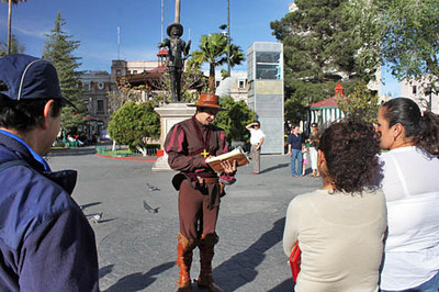 Tour guide in period costume at Plaza de Armas