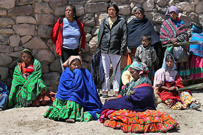 Tarahumara Women sit in the church courtyard