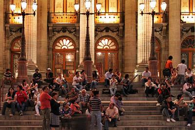 Crowds gather at night on steps of Teatro Juarez