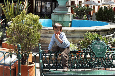Child plays in Plaza San Fernando