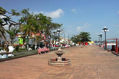 Plaza Colon runs along the river