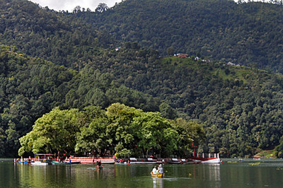 Boats paddle to Barahi Temple, on an island in Phewa Lake