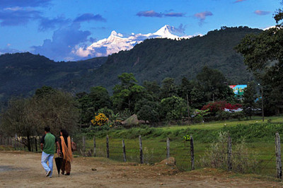 Annapurna Himalayas peel over hills surrounding Phewa Lake