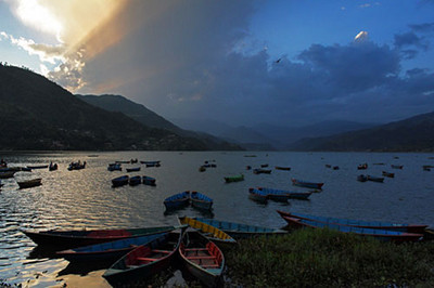 Boats and clouds at sunset on Phewa Lake