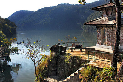 A small roadside temple overlooks Phewa Lake