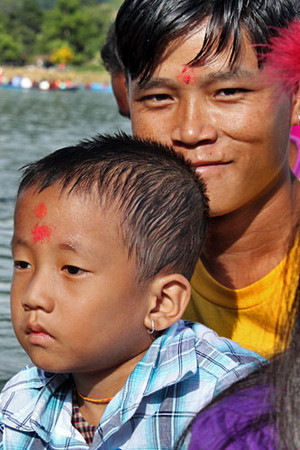 "Devotees get forehead ""tikas"" from the priest at the temple"