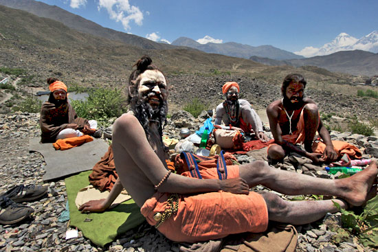 Sadhus solicit donations in front of Muktinath Temple