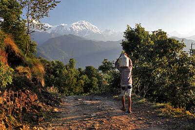 Local man carries fresh buffalo milk down he mountain
