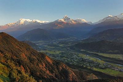 Dawn lights up peaks of the Annapurna Himalayas