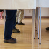 Voters cast their ballots at the polls at the Atkinson Community Center on Tuesday.  Photo by Ryan Hutton.