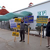 Russ Frydryck, left, and Maria Bertolone hold signs outside the polls at Rockingham Park in Salem.Photo by Mary Schwalm