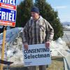 Former Police Chief and Selectmen's Candidate Philip Consentino holds a campaign sign outside the polls at the Atkinson Community Center on Tuesday.  Photo by Ryan Hutton.