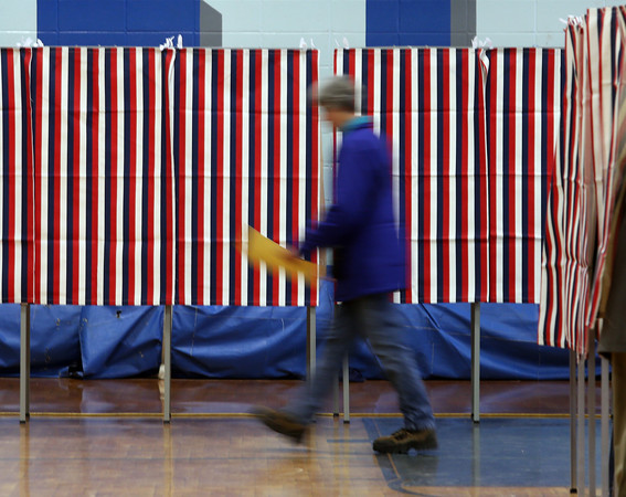 A voter proceeds to the check out at Pelham High School in Pelham.  Photo by Mary Schwalm