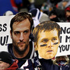 MARY SCHWALM/Staff photo Fans of Denver Broncos wide receiver Wes Welker and New England Patriots quarterback Tom Brady hold signs during the first half of their NFL football game in Foxborough. 11/24/13