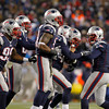 MARY SCHWALM/Staff photo New England Patriots defensive back Nate Ebner, third from right, is congratulated by teammates after recovering a fumble to set up the game winning field goal during overtime of their NFL football game against the Denver Broncos in Foxborough. 11/25/13