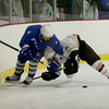 Methuen's Dale Armstrong (4) and Haverhill's Jordan Perez (6) vie for the loose puck.  Photo by Mary Schwalm