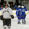 Haverhill's Tom Maguire reacts as Methuen players celebrate a goal.  Photo by Mary Schwalm