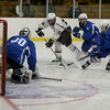 Haverhill player Matt Arena (16) tries to get a shot on Methuen goalie Chris Milone (30) as Dale Armstrong (4) and Dylan Yameen (19) defend.  Photo by Mary Schwalm