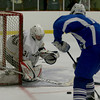 Haverhill's Mike Gleason makes a save on a shot attempt by Methuen's Ryan Bradley.  Photo by Mary Schwalm