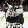 Haverhill players surround teammate Matt Arena after he scored a goal.  Photo by Mary Schwalm