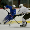 Methuen's Ryan Cioffi changes direction as Haverhill's Eric Michitson (3) defends during their hockey game in Haverhill.  Photo by Mary Schwalm