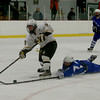 Methuen's Ryan Bradley (18) dives after the puck as Haverhill's Bryan Bellemore tries to get a shot on goal.  Photo by Mary Schwalm