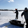 Michael Jaskelevicus, 15, of Haverhill, left, Jacob Flanagan, 15, of Haverhill, and Ken Davis, of Groveland, work together to rebate a hook during the Haverhill Hound Rod & Gun Club's 2014 Ice Fishing Derby on Chadwick Pond in Haverhill.  Photo by Mary Schwalm